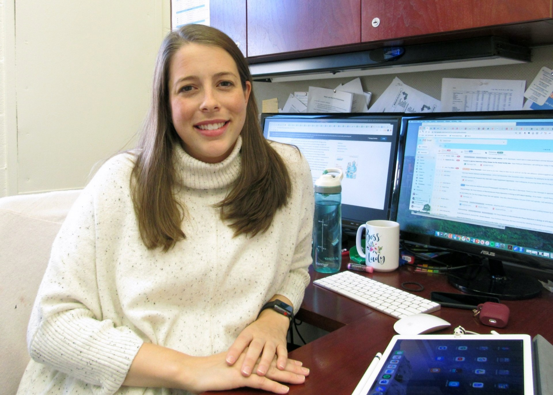 Allie Obermeyer, PhD, sitting at desk in office